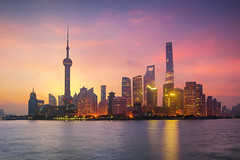 Pudong Skyline at sunrise (anekphoto) Tags: shanghai pudong lujiazui sunlight tower clear oriental river travel day destinations panoramic locations skyline people sun asia reflection architecture flare huangpu financial exterior china cityscape skyscraper downtown ferry no copy chinese sunrise cultures urban landmark culture built awe morning communications building district place sparse lens famous city blue sky dawn boat scene water space structure pearl international