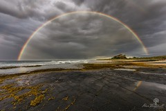 Meant To Be (Dave Brightwell) Tags: northumberland bamburgh bamburghcastle rainbow storm stormy reflections photography sky rocks beach coast clouds canon castle seascape