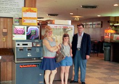Slightly blurry shot of Mom, Sis and Dad at the mod and groovy Connecticut Turnpike (I-95) Fairfield rest stop. Psychedelic signs for the new Connecticut Lottery, a giant popcorn machine, 1960s modern lighting and linoleum tiles. Just too cool! June 1973. (wavz13) Tags: oldphotographs oldphotos 1970sphotographs 1970sphotos oldphotography 1970sphotography vintagesnapshots oldsnapshots vintagephotographs vintagephotos vintagephotography historicphotographs historicphotos historicphotography vintagemilford oldmilford 1970smilford vintagewoodmont oldwoodmont 1970swoodmont connecticutphotographs connecticutphotos oldconnecticutphotography oldconnecticutphotos oldconnecticut vintageconnecticut connecticutphotography vintagenewengland oldnewengland 1970snewengland vintagenewenglandphotography oldnewenglandphotography vintagenewenglandphotos oldnewenglandphotos oldfamilyphotos vintagefamilyphotos oldfamilyphotography vintagefamilyphotography 110film kodacolor analogphotography filmphotography instamatic pocketinstamatic vintagekids vintagechildren vintageteens vintageteenagers teenmemories teenagememories vintageteengirls vintageteenagegirls oldclothes vintageclothes oldclothing vintageclothing oldreststops vintagereststops 1970shighways 1970shighway oldhighways oldhighway snapshots grain grainy woodpaneling futurama