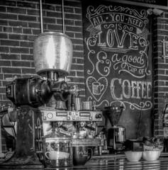 The Grind (clarkcg photography) Tags: erlyrush coffee coffeeshop coffeehouse bricks coffeegrinder oldantiquecoffeegrinder chalk blackboard slateboard cups 7dwf blackandwhitethursday7dwf