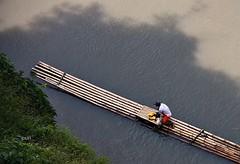 O pescador!! (puri_) Tags: picmonkey indonesia lago barco canas pescador