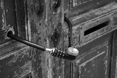door locked (marcobertarelli) Tags: door lock black white bw locked key contrast wood