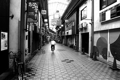Along the closed stores (pascalcolin1) Tags: japan osaka vlo bike magasin stores photoderue streetview urbanarte noiretblanc blackandwhite photopascalcolin ferm closed
