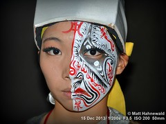 2013-12a Prettifying Taiwanese Faces (06) (Matt Hahnewald) Tags: matthahnewaldphotography facingtheworld photo flash nightshot image closeup streetportrait outdoor worldcultures cultural oneperson character people female youngadult ethnic horizontalformat human face eyes eyecontact photography consent facepainting empathy rapport portrait mask portraiture travelportrait traveldestination colour 43aspectratio posing asia eastasia taiwan kaohsiung chinese nikond3100 nikkorafs50mmf18g travel tourism colourful enface frontview tradition facialexpression paintedface festival beautiful incredible kaohsiungarena facepaint traditional makeup paintedfacemask dancer chineseoperamask halfmask attitude