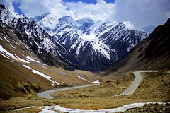 Piercing the mountains. (najeebmahmud) Tags: nikon nikond810 d810 nikkor 2470mm nikkor2470mm asia landscape light snow rocks mountain mountains white clouds wow awesome vacation pakistan summer yellow lines line sky skyline fence