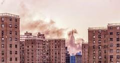 Empire State Building, Public Housing View,2 (Karm Redland) Tags: empirestatebuilding smoke fire nyc karmredland publichousing bluebuilding newyork viewfrombrooklynbridge nikon nikon750 sigma sigma35mm