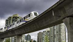 Cause and effect (Tony Tomlin) Tags: sky train skytrain transit bc bctransit burnaby condos tracks elevatedrailway