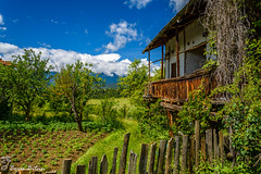 calmness (borisbitsin) Tags: old summer house nature field clouds landscape bulgaria calmness  godlevo