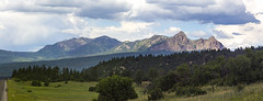 0718 Mountains from highway (8 pano) (movies05) Tags: nm newmexico project365 clouds geography geology highway landscape mountains nature pano panorama roadtrip trees