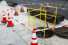 Manhole (wwward0) Tags: cc lincolncenter manhattan manhole nyc overcast safety sidewalk trafficcone upperwestside uws wwward0 newyork unitedstates us