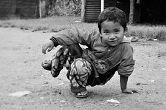 Relax (vankerkoven.ludovic) Tags: kid boy nepal relax posing cute play palung daman school garden bw travel summer
