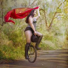 'Balanced Learning Curve' (Natasha Root Photography) Tags: natasharootphotography imagine inspire create painterly red green unicycle hat surreal balance tophat park ride learning lady fishnet boots