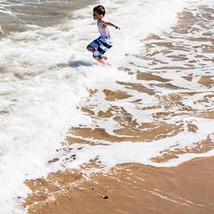 WaveJump (glennk2611) Tags: sun abstract beach birds children pier seaside sand waves norfolk leafs cromer