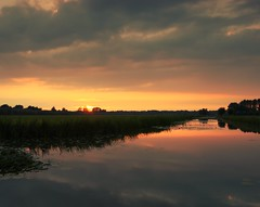 Dutch polder sunset (M a u r i c e) Tags: sunset sunlight water netherlands reflections canal cloudy dusk wideangle polder efs1022mm ultrawidezoom