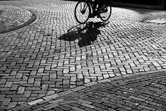 Bicycle (pavel.suva) Tags: street city shadow blackandwhite monochrome amsterdam bike bicycle pavement streetphotography streetphoto shadowplay
