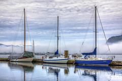 Sailboats (Paul Rioux) Tags: marine marina reflections sailboat sailboats calm boats boat canada britishcolumbia bc harbour reflection seashore seaport ship shipsboats ships tiedup vancouverisland vessels vessel waterfront westcoast wharf clouds prioux cowichan bay blue wow