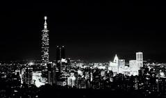 Taipei Noir - 01 (bluetrayne) Tags: city longexposure nightphotography urban building monochrome architecture skyscraper asia cityscape taiwan citylights taipei analogphotography  blackandwhitephotography