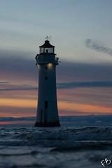 Wavey Lighthouse (frisiabonn) Tags: lighthouse waves water waterfront shore beach sunset sun dark light glow new brighton river mersey merseyside england uk great britain architecture seaside outdoor maritime
