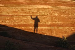 selfie @ sunset (twurdemann) Tags: statepark colour valleyoffire silhouette pattern photographer shadows unitedstates stripes nevada erosion terry mojavedesert selfie weathering americansouthwest firewave redsandstone nikcolorefex tonalcontrast xf1855mm fujixt1