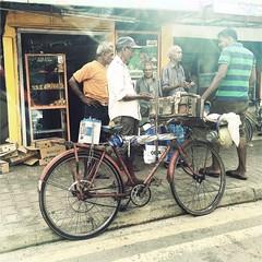 Jogo do bicho srilanqus.  #Hipstamatic #G2 #Irom2000 #StreetPhotography  #lottery #srilanka #ceylon #colombo #citylife #bike #people (Bruno Abreu) Tags: instagramapp square squareformat iphoneography uploaded:by=instagram