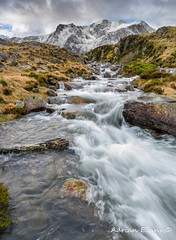 Winter Stream (Adrian Evans Photography) Tags: ygarn snowdonia winter idwal water idwalstream snow ogwenvalley wales waterfall uk northwales devilskitchen glyderau glyderaumountains stone twlldu cwmidwal landscape snowdonianationalpark landmark stream outdoor llynidwal smooth longexposure glyderfawr river adrianevans nationalpark clouds rocks glyderfach snowcapped ogwen sky mountain d800 nikon 20mm