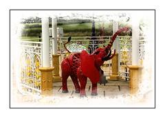 Red Elephant (Audrey A Jackson) Tags: canon60d britishironworkscentre shropshire metalwork artwork colour elephant red yellow smartphotoeditor wroughtironwork gazebo fields 1001nightsmagiccity