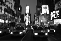 Times Square 080614-1 (gcohenphotography) Tags: street city newyorkcity sky blackandwhite bw cars window wet rain silhouette fog night scrapers buildings lights movement chaos cabs hustle