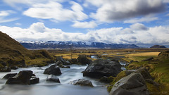 In Iceland you're never far from a river and a mountain (lunaryuna) Tags: longexposure sky clouds river season iceland spring rocks le riverbed lunaryuna cloudscape meandering landscpe southiceland eyjafjallajokull gluggafoss seasonalchange moutnainscape rivermerkja