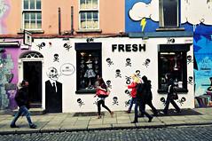 People walking on the sidewalk in front of Fresh shop in Dublin - Temple Bar quarter (PascalBo) Tags: street ireland people dublin woman man shop wall graffiti nikon europe magasin femme capital capitale rue mur templebar homme irlande d300 ire pascalboegli