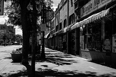 Triangle (patrickkuhl) Tags: street people blackandwhite monochrome wisconsin 35mm blackwhite fuji shadows state streetphotography madison fujifilm madisonwi statestreet minox wisco wisc colorminotar xe2 lensconversion