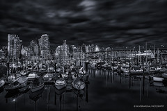 The Moment between Calm & Chaos (TIA International Photography) Tags: vancouver britishcolumbia canada falsecreek bc marina granville bridge yaletown urban landscape boat sailboat sailing bay water reflection dock harbor skyscraper building cityscape city overcast grey steely sky clouds illumination tiainternationalphotography tosinarasi fishermens wharf pier monochrome visipix