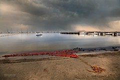 Calm before the storm (gregoryphoto150) Tags: seascape landscape beach nets boats reflection outdoor seaside coast shore sky storm clouds sea mar marmenor santiago ribera espaa spain net calm