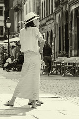 The elegant of the Belle Epoque... (Periades) Tags: bw blackandwhite blackwhite candid chapeau fille femme girl human hat nb noiretblanc sepia photoderue pavement pav rue streetphotography street streethuman mode fashion woman white