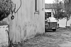 () Tags: outdoor young kids car buildings village countryside truck trees house ground bw children architecture nature blackandwhite face monochrome greece fuji portrait digital fujix70