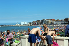Getting ready for the beach (Davydutchy) Tags: margate kent uk truk tatra register annual rally beach seafront strand zee meer sun bathe swim hot day people teen boys shorts trunks crowd packed sunbathing july 2016 butterfly seagull umbrellas