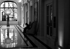 In the hotel's hall (pascalcolin1) Tags: parie16 hotel hall lumire ombre fentre window fauteuil chair reflets reflection photoderue streetview urbanarte noiretblanc blackandwhite photopascalcolin