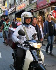 Itaewon Motorbike Man (Mondmann) Tags: street man asia afternoon helmet streetphotography korea motorbike transportation seoul mobilephone southkorea rider handphone rok itaewon eastasia republicofkorea motorbiker mondmann canonpowershots120
