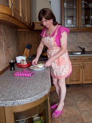 Cooking (blackietv) Tags: pink cooking kitchen floral dress crossdressing tgirl apron transgender transvestite housewife crossdresser pinafore