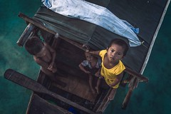 Kids on a boat (Syahrel Azha Hashim) Tags: ocean travel light vacation portrait people holiday detail beautiful 35mm island prime boat community colorful southeastasia dof getaway sony details naturallight portraiture transportation malaysia handheld local shallow moment woodenboat simple sabah asean fishingvillage simplelife seagypsies a7ii colorimage denawanisland sonya7 syahrel ilce7m2