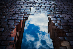 334/365 Crevasse (ewitsoe) Tags: ewitsoe puddle reflection sky buildings street nikond80 35mm streets urban city citylife cityscpae poznan poland water clouds mirror cloudy summer citystreet staryryenk oldmarket