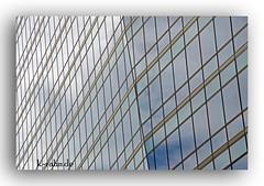 Glasfassade (K.Rahn) Tags: backgrounds klar konstruktion reflektor sunlight architektur aussen blau blickwinkel detail fassade fenster gebude gebudeteil gegensatz glas glaspalast glnzend haus hell himmel himmelblau kontrast modern moderne neu sonne spiegel spiegelung wolke wolken fotorahmen outdoor