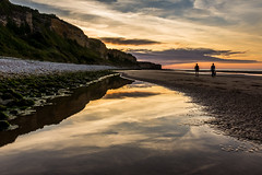 Sunset Omaha Beach (Peter Gol) Tags: canoneos60d canoneos60d1585 omahabeach viervillesurmer sun sunset sunlight reflection reflections beach sea ocean water waterscape landscape seascape france frankrijk normandi normandy cliff clouds rocks