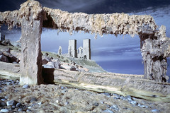 Reculver (colour edit) (Sean Hartwell Photography) Tags: church towers reculver kent england uk groynes seaside sea seaweed decay abandoned ruins beach ir infrared falsecolour canoneosm 22mm
