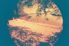 Beach (whatkeirasaw) Tags: scotland lomo lomography fisheye lochlomond redscale fisheye1 scottishsummer whipcrack