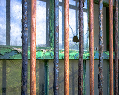 Breaking Free (Fourteenfoottiger) Tags: colour abandoned broken window glass freedom rust bars ruins break patterns angles rusty wideangle textures prison jail smashed windowpane cracked ruined breakout breakingfree