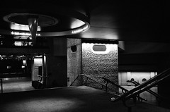 Barbican interior (Jim Davies) Tags: olympusmjuii olympusstylusepic monochrome mjuii stylusepic ilford xp2 c41 chromogenic 35mm analogue veebotique olympus london barbican architecture modernism brutalism concrete buildings blackwhite bw filmfilmforever ishootfilm film