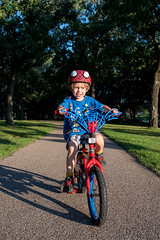 Spiderbug on the move! (Out of Focus [sic]) Tags: nanowes bike spiderman riding sun bright park