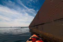 Yeah your boat is bigger! (4thmedium) Tags: rusted kayak lake ontario proportion