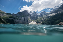 Cool down (chriscom) Tags: switzerland lake oeschinensee water blue alps kandersteg mountains