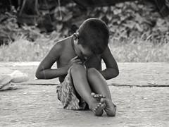 She's trying to open something (Shafi Uddin1) Tags: streetportrait streetsofcity streetphotography street bangladeshstreetphotograph streetscene streetchild streetkid streetsofbangladesh streetside streetofbangladesh horizontal asianchildportrait portrait rainportrait blackwhiteportrait childportrait bangladeshichildportrait poorchildren bw poor alone asia bangali bangladesh mymenshing railwaystationplatform railwaystation citylife life nikkor nikon nikkor40136mm nikoncoolpixl830 nikonlens nikoncoolpix ngc supershot julia marco raxon k agostino prosession pamela ananabanana